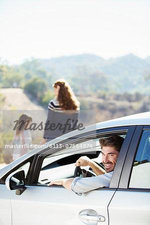 Portrait of happy man inside of car