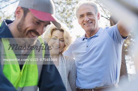 Roadside mechanic helping senior couple