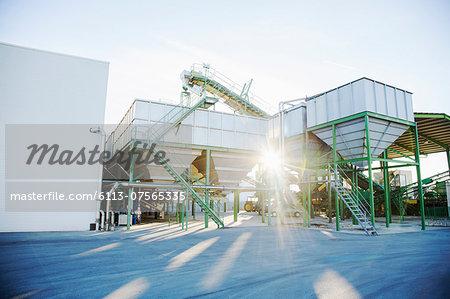 Sun shining behind granary