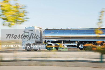 Stainless steel milk tanker on the road