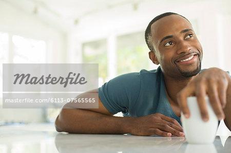 Pensive man drinking coffee