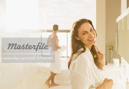 Portrait of smiling woman in bathroom