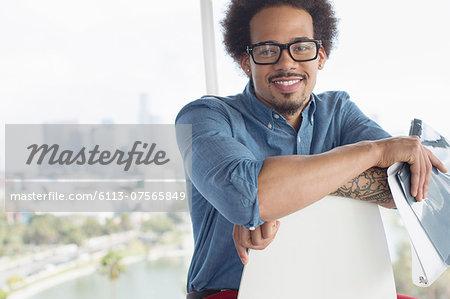 Portrait of confident businessman holding folder