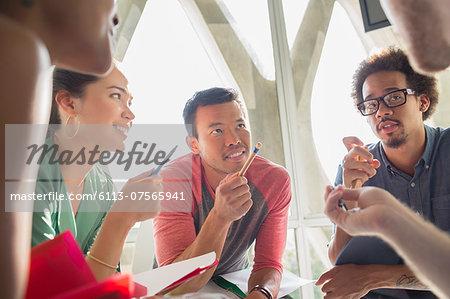 Creative business people brainstorming in circle
