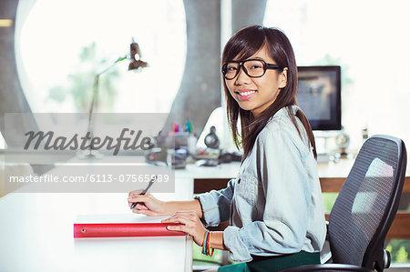 Portrait of confident businesswoman working at desk