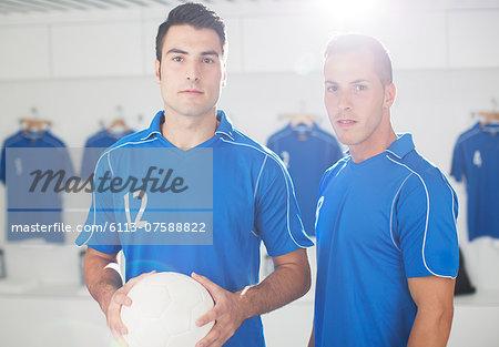 Soccer players standing in locker room
