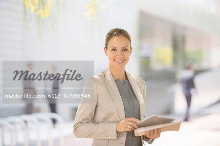 Portrait of confident businesswoman with digital tablet