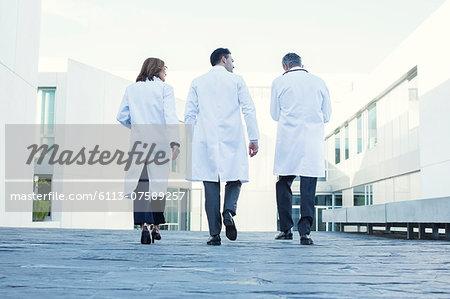 Doctors walking on rooftop