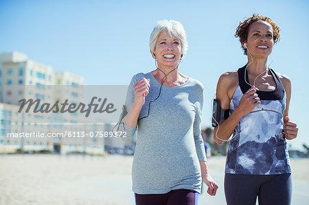 Senior women jogging outdoors
