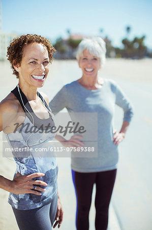 Portrait of smiling women in sportswear outdoors