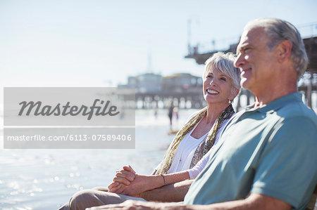 Senior couple relaxing on sunny beach