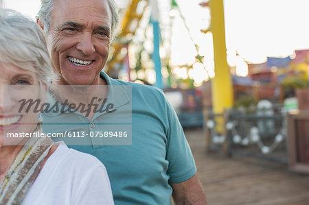 Portrait of senior couple at amusement park