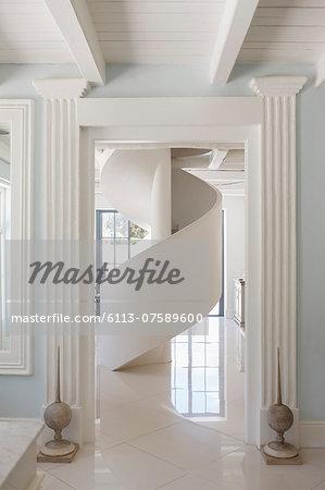 Spiral staircase in luxury foyer