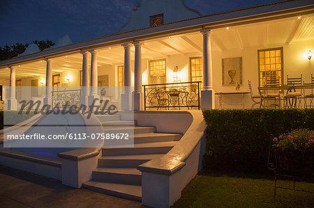 Luxury house with porch illuminated at night