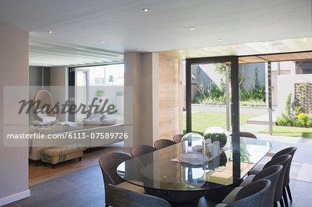 Luxury dining room open to sunny patio