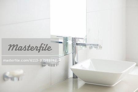 Sink in sunny modern bathroom
