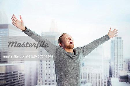 Exuberant man in urban window