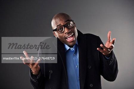 Portrait of businessman shrugging