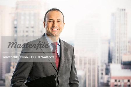 Portrait of confident businessman in urban window