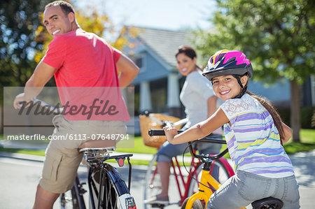 Portrait of family riding bikes on street