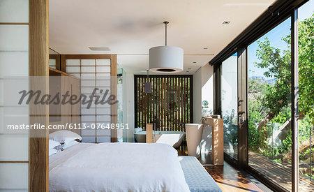 Sunny modern bedroom with en suite bathroom
