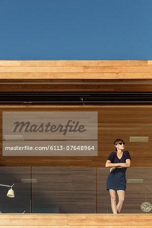 Woman standing on luxury balcony