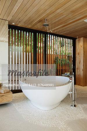 Modern soaking tub in bathroom