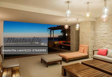Luxury patio overlooking ocean at night