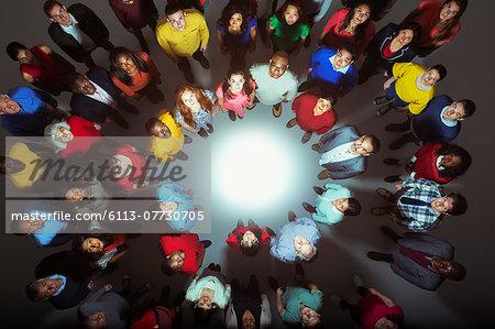 Portrait of confident business people around bright light