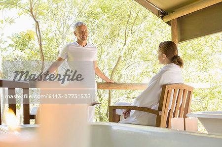 Couple talking on rustic balcony