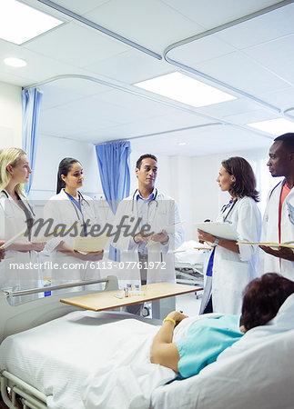 Doctor teaching residents in hospital room