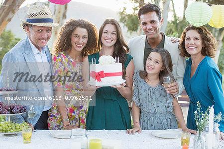Family celebrating birthday with cake