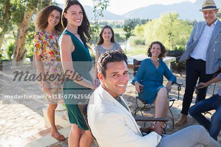 Family gathered on backyard patio