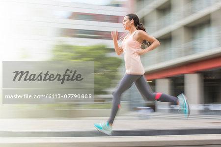 Woman running through city streets