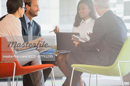 Business people having meeting in office building