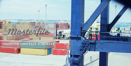 Workers talking on cargo crane
