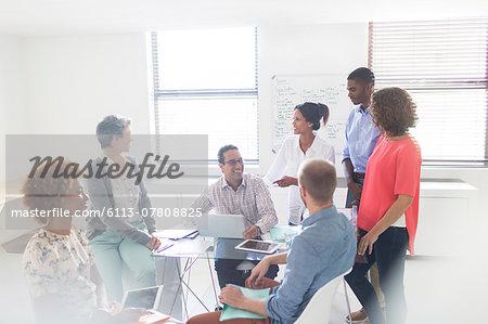 Group of business people having meeting in modern office