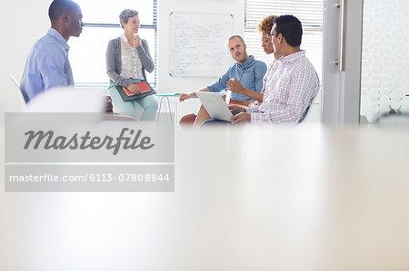Group of business people having meeting in modern in office
