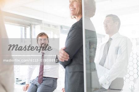 People having meeting in modern office