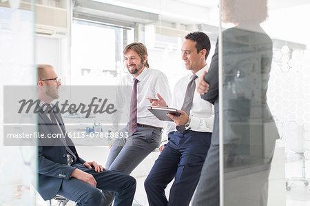 Businesspeople having meeting in modern office