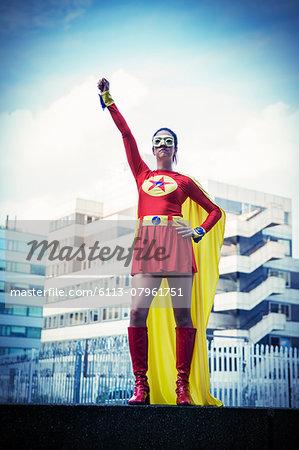 Superhero standing proudly in city