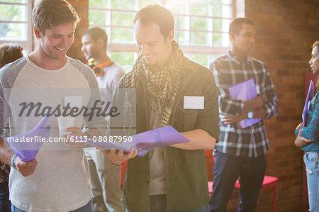 Men reading paperwork at community center