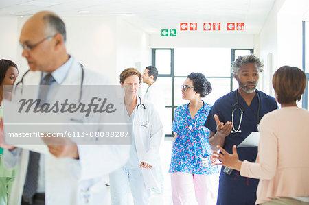 Doctors and nurses in hospital corridor