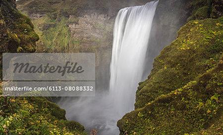Waterfall surrounded by mossy rocks, Trolls View, Skogarfoss, Iceland