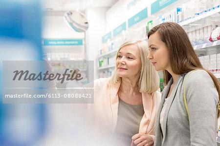 Customers shopping in pharmacy