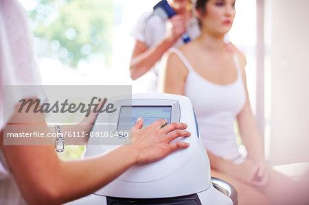 Physical therapist programming ultrasound machine