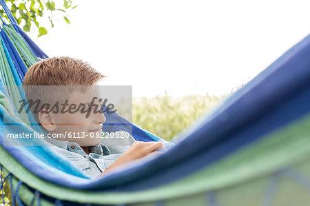 Boy relaxing in hammock