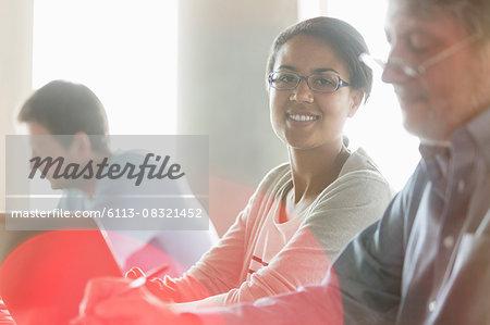 Portrait confident businesswoman at laptop in meeting