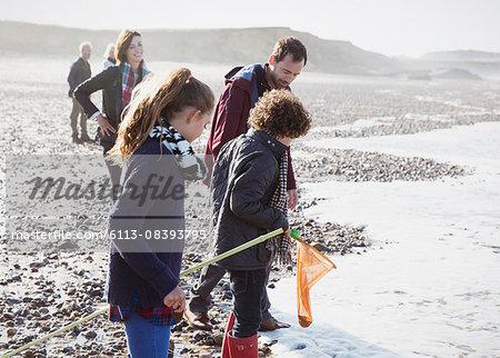 Multi-generation family clamming on rocky beach