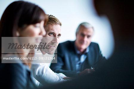Businessman listening in meeting